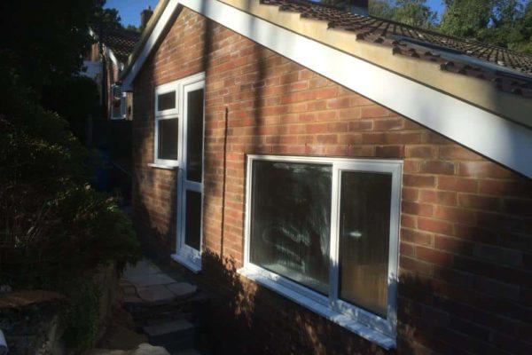 Extension exterior view of door, window and roof work